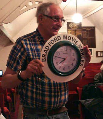 Older man holding a clock for the Bradford Movie Makers