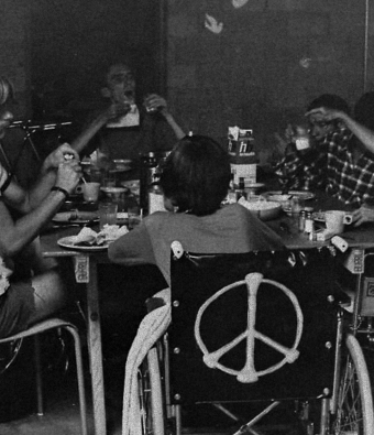Crip Camp attendees sitting around table