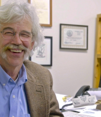 journalist Art Cullen at his desk in Storm Lake